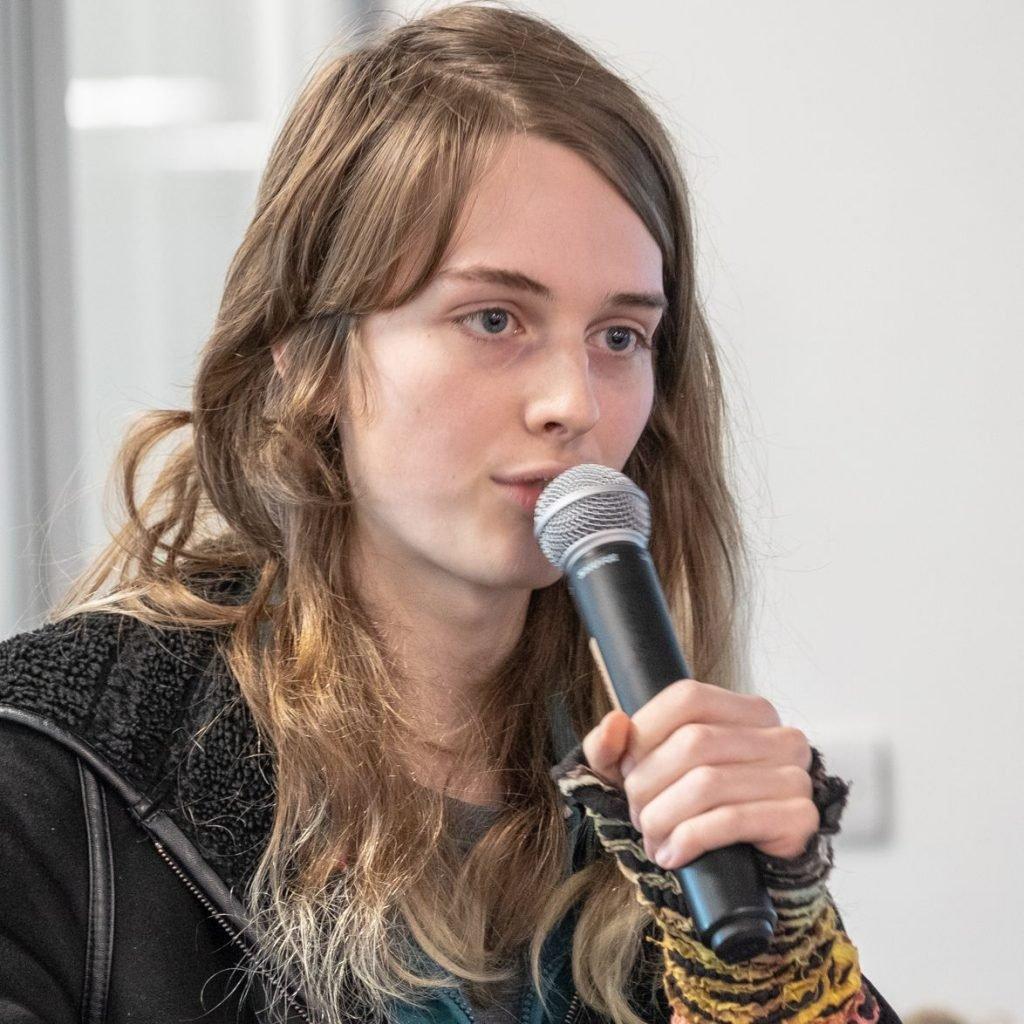 Free software developer Alyssa Ross talking through microphone